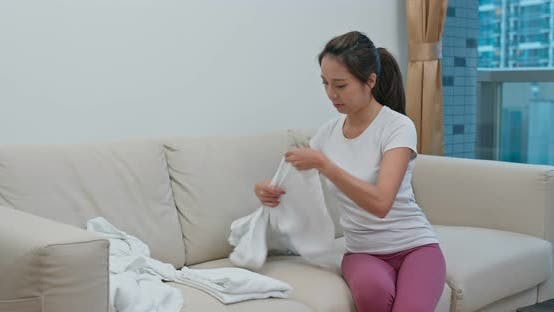 Thumbnail for Woman fold towel at home