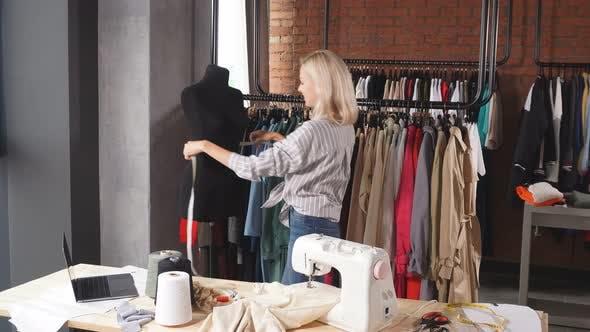 Attractive Fashion Designer Measuring Mannequin