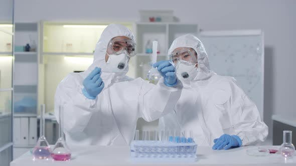 Thumbnail for Chemists Performing Experiment in Laboratory