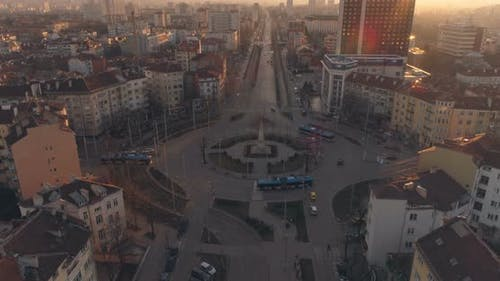 Busses and Public Transportation Driving Through Roundabout at Sunset in Sofia, Bulgaria