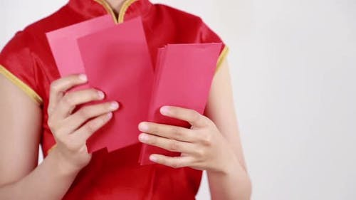 hand counting red envelope in concept of happy chinese new year