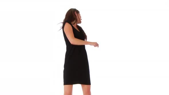 Thumbnail for Young woman dancing on white background