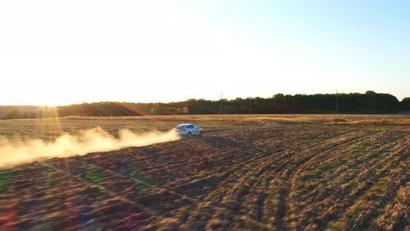 Thumbnail for Aerial Shot of Electrical Car Moving on Off-road Route Leaving Dust Trail Behind. New Auto Driving