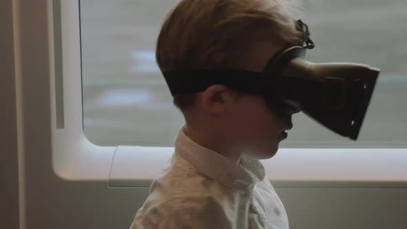 Cover Image for Child Having Fun in the Train with VR Glasses