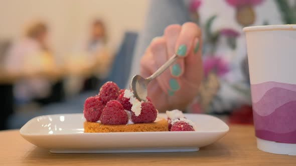 Eating dessert with raspberries