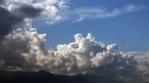Thumbnail for Dark Rain Clouds Over Distant Mountains