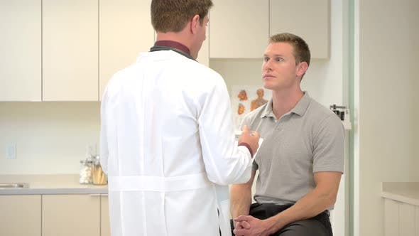 Doctor consulting patient in clinic