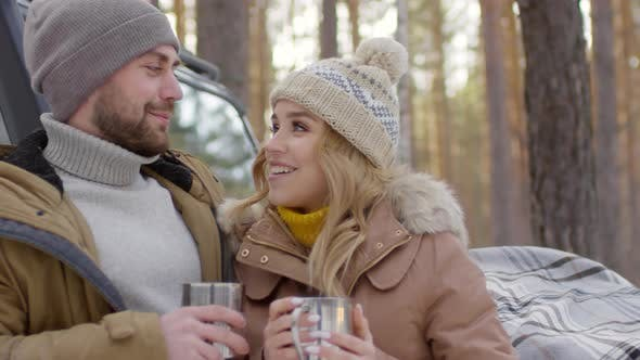 Thumbnail for Happy Couple Drinking Hot Tea in Forest