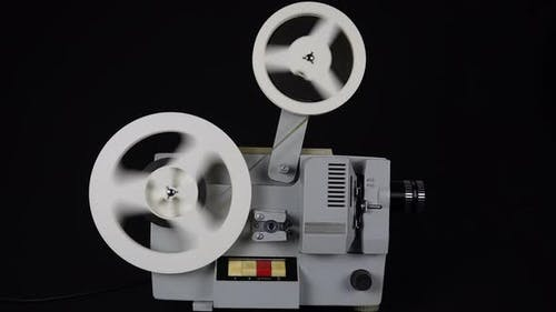 Rewinding Tape In An Old Movie Projector.