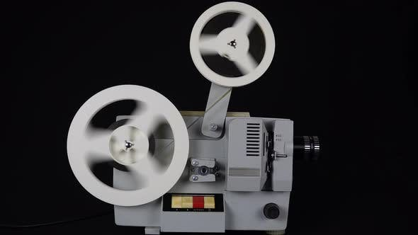 Thumbnail for Rewinding Tape In An Old Movie Projector.