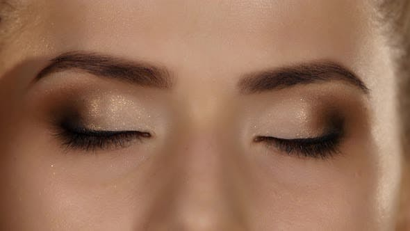 Cover Image for Eye Makeup Woman Applying Eyeshadow Powder, Beautiful Woman Face, Closeup