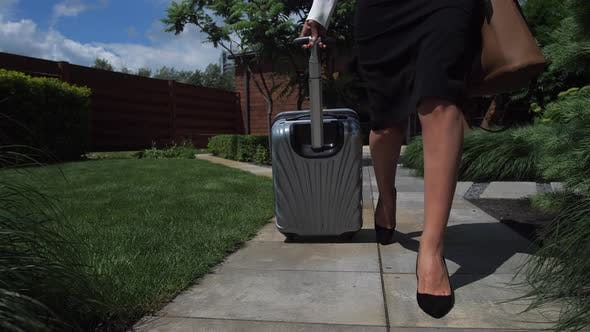 Thumbnail for Businesswoman with Suitcase Walking To Car