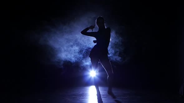 Thumbnail for Dancing Girl Rumba in Studio, Silhouette. Blue Backlight