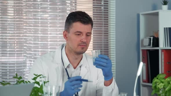 In Modern Chemistry Laboratory Research Scientist Is Amazed By the Result of Experiment