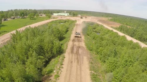 Flying Over the Tank on Rough Ground of Training Area