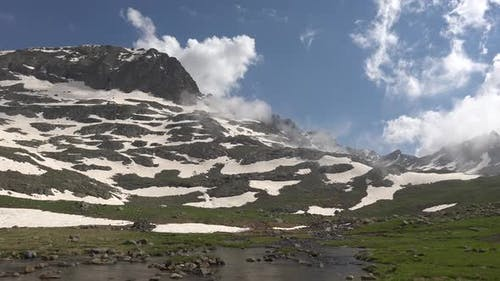 Panoramic Alpine Meadow and Stream in High Altitude Mountain
