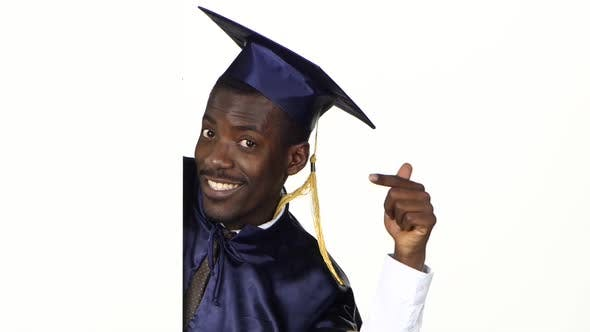 Thumbnail for Frightened Graduate Pointing To the White Card. White. Close Up