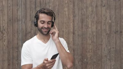 Dude Listening To Music Through Headphones