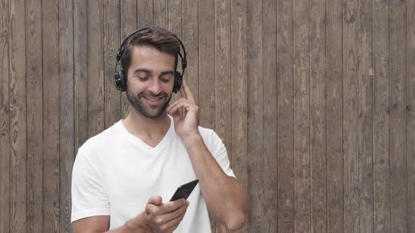 Dude Listening To Music Through Headphones