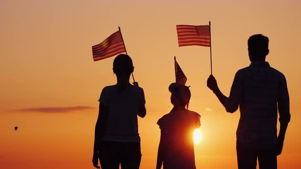 Thumbnail for Happy Family with Child Waving US Flags at Sunset, Rear View