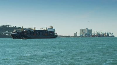 Cargo container ship approaching port