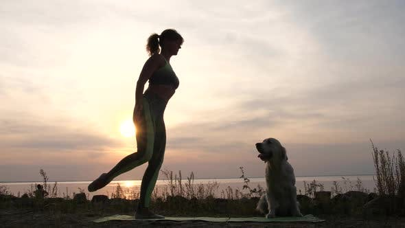 Thumbnail for Fit Woman Practicing Yoga Balance Pose at Sunset