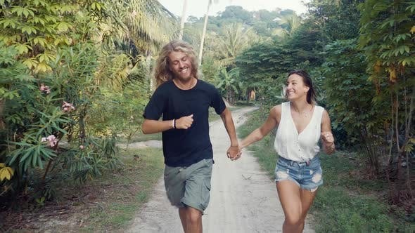 Thumbnail for Couple Running On Tropical Island