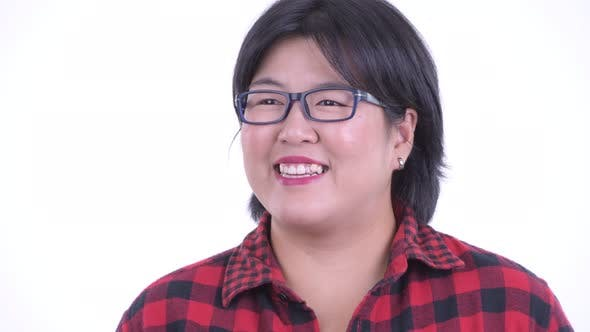 Thumbnail for Face of Happy Overweight Asian Hipster Woman Thinking