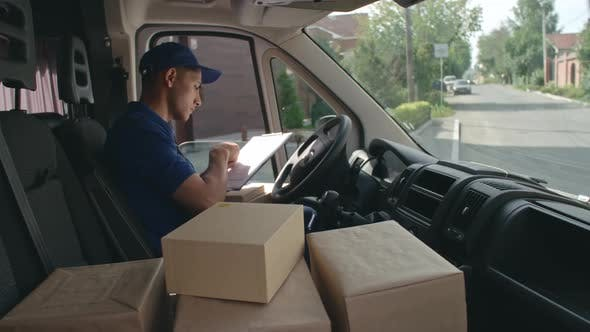 Thumbnail for Young Delivery Driver Doing His Job