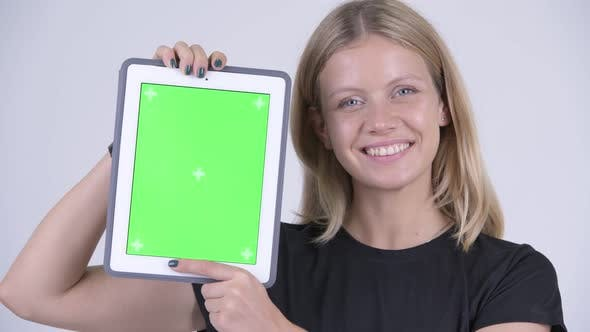 Thumbnail for Face of Young Happy Blonde Woman Showing Digital Tablet