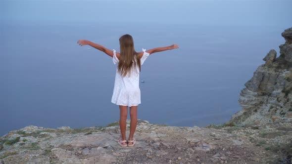 Thumbnail for Happy Kid Outdoor on Edge of Cliff Seashore