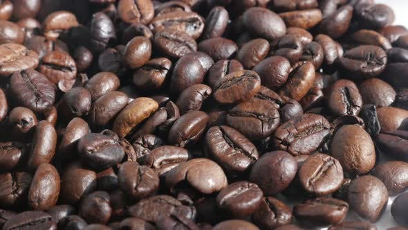 Thumbnail for Mixed Arabica and robusta coffee beans 4K slow pan footage