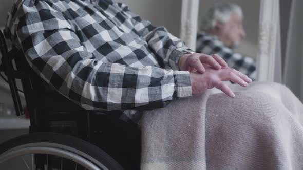 Thumbnail for Camera Approaching To Unrecognizable Man's Hands Shaking. Elderly Disabled Man Sitting in Wheelchair