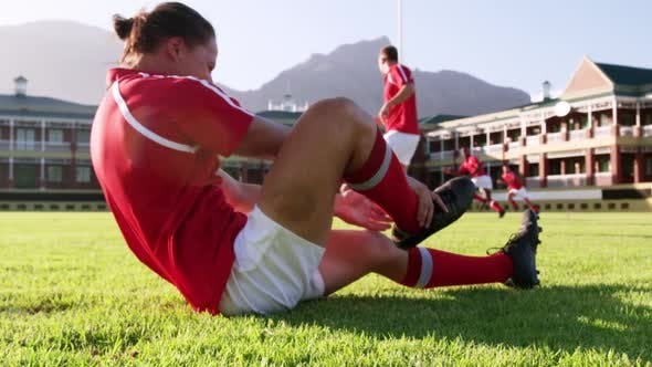 Thumbnail for Male rugby player sitting on the ground in stadium 4k