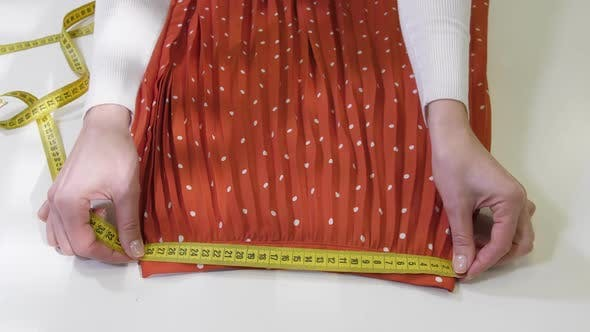 Thumbnail for Hands Measuring Pleated Skirt Before Dry-cleaning