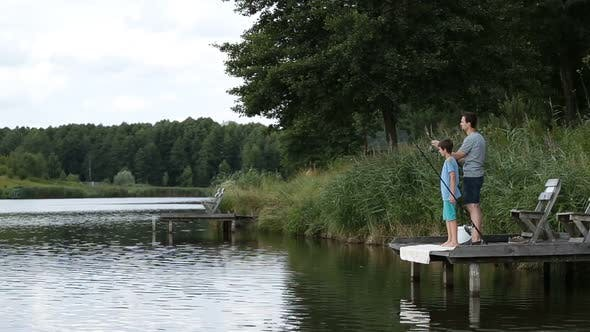 Thumbnail for Fisherman with Spinning Rod Catching Fish on Lake