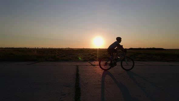 Thumbnail for Silhouette of Mountain Biker at Sunset, Slow Motion