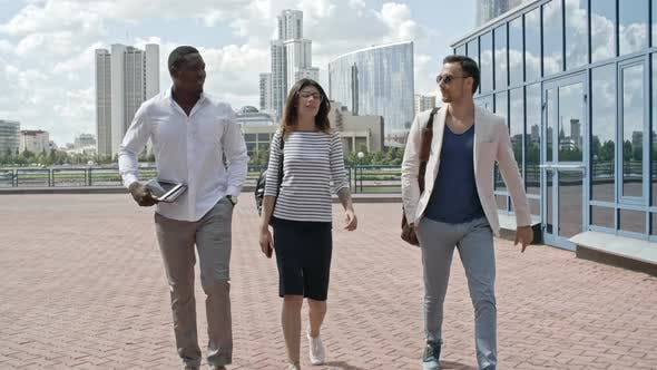 Thumbnail for Group of Coworkers Walking Outdoors near Business Center