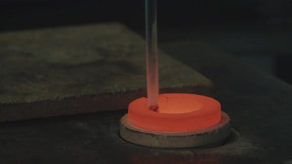 Thumbnail for Molten Gold Being Poured Into Ingot Moulds