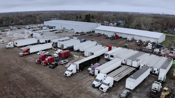 Aerial Drone View of Truck Repair Shop Service Building and Many Trucks Near It