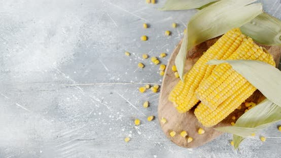 Thumbnail for Corn with Leaves on a Cutting Board.