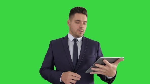 Thumbnail for Businessman Presenting From the Tablet on a Green Screen, Chroma Key