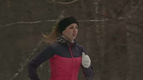 Thumbnail for Sporty Young Woman Jogging in Winter Forest