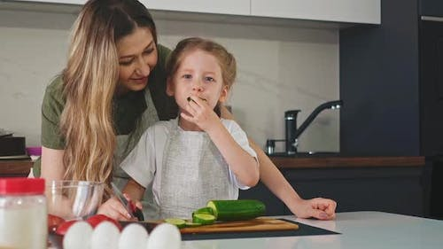 Daughter and Mother Cook Together