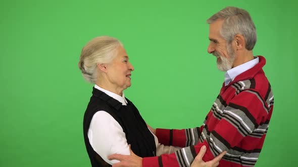 Thumbnail for An Elderly Couple Hugs and Talks, Then Smiles at the Camera - Green Screen Studio