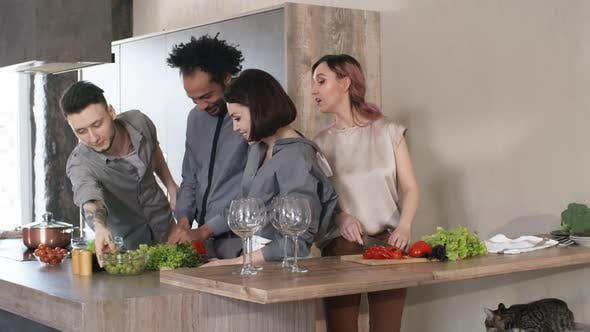 Cover Image for Young Couples Cooking Dinner Together