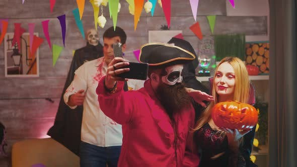 Spooky Bearded Pirate Taking a Selfie with Beautiful Repear Woman