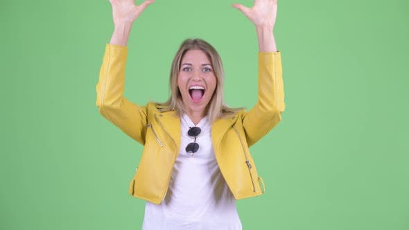 Thumbnail for Happy Young Rebellious Blonde Woman with Surprise Gesture