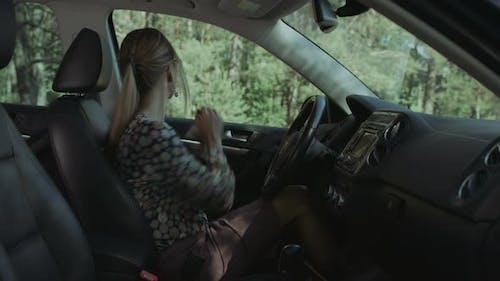 Elegant Beautiful Woman Fastening Car Seat Belt