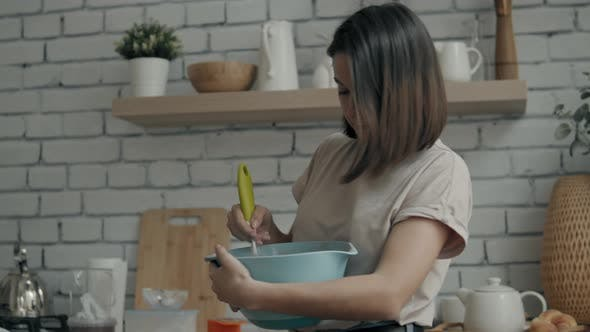 Woman in the Kitchen Cooking